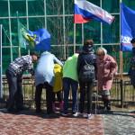"""Участники интерактива """"Одень мамонтёнка в цвета российского флага"""""""